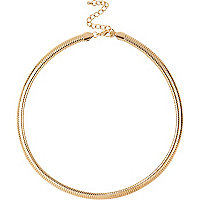 Gold tone slinky short necklace