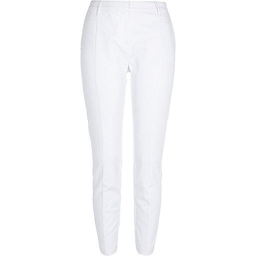 White slim trousers