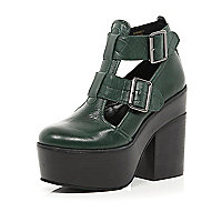 Dark green cut out platform shoe boots