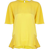 Yellow frilly panel oversized top