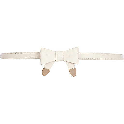 Cream skinny bow jeans belt
