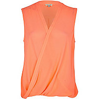 Bright coral sleeveless wrap blouse