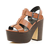 Tan wooden platform sandals