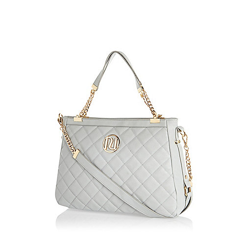 Pale blue quilted chain handle tote bag