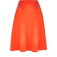 Orange zip pocket midi skirt