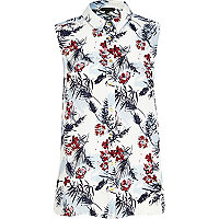 White floral print sleeveless shirt