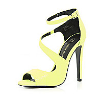 Bright yellow asymmetric stiletto sandals