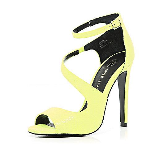 Bright yellow asymmetric stiletto sandals