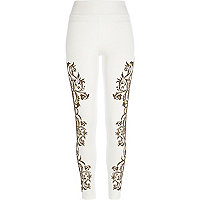 White beaded leggings