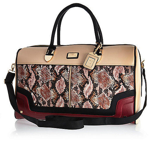 Red snake print weekend bag