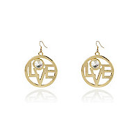 Gold tone love disc earrings