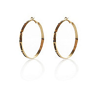 Gold tone engraved word hoop earrings