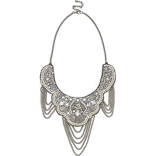 Silver tone draped chain statement necklace