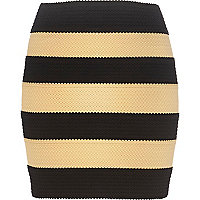 Black and nude bandage mini skirt