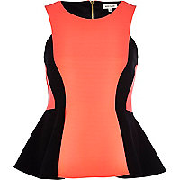 Bright pink colour block peplum top