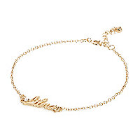Gold tone Libra bracelet