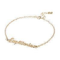 Gold tone Sagittarius bracelet