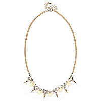 Gold tone heart and spike necklace