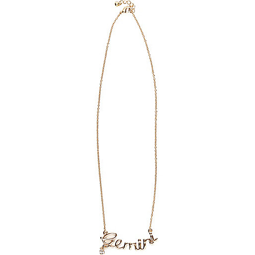 Gold tone Gemini necklace