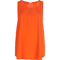 Bright orange curved mesh panel shell top