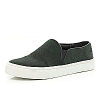 Dark green textured plimsolls
