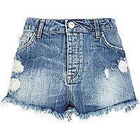 Mid wash high waisted ripped denim shorts