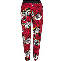 Red geometric floral print joggers