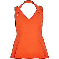 Bright red halterneck peplum top