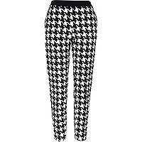 Black and white dogtooth cigarette trousers