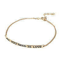 Gold tone all you need is love bracelet