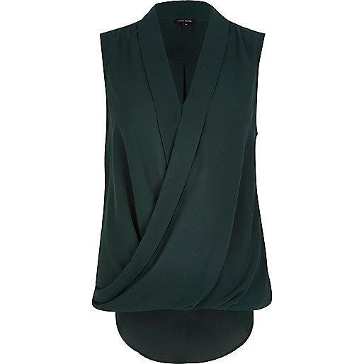 Dark green sleeveless wrap blouse