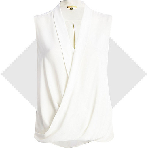 White sleeveless wrap blouse