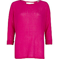 Bright pink loose knit top