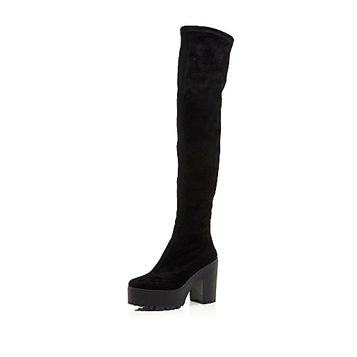 Black cleated platform over the knee boots