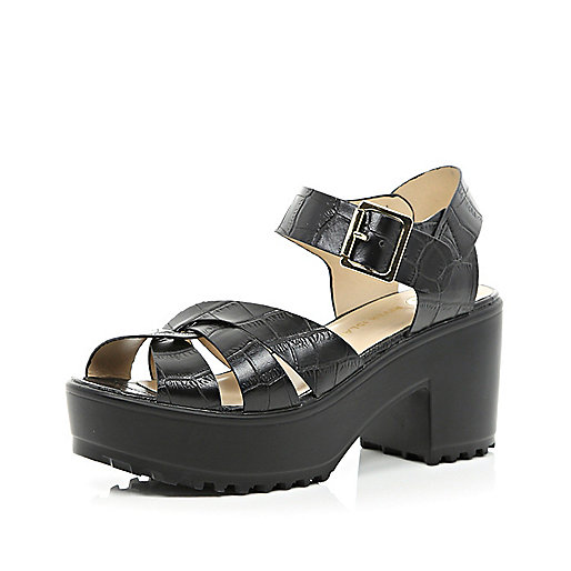 Black cross strap cleated sole sandals