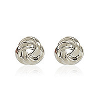 Silver tone knot stud earrings
