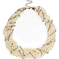 Gold tone pearl and crystal twisted necklace