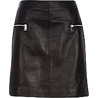 Black leather zip mini skirt