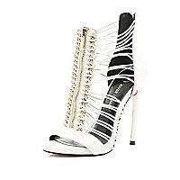 White strappy zip heels