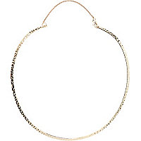 Gold tone textured torque necklace