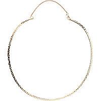 Gold tone textured torque necklace