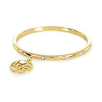Gold tone love bangle