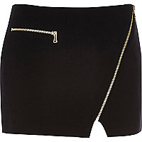 Black asymmetric zip mini skirt