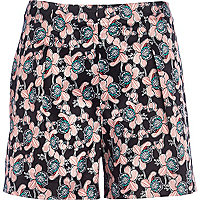 Red high waisted floral print shorts