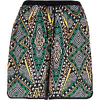 Dark green aztec print board shorts