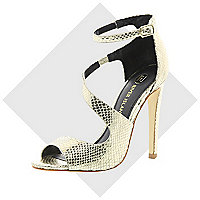 Gold asymmetric stiletto sandals