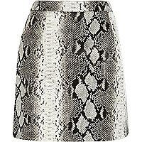 Black snake print leather look mini skirt