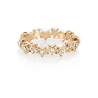 Gold tone star repeat thumb ring
