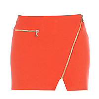 Orange asymmetric zip mini skirt