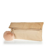 Cream leather fold-over pom pom clutch bag